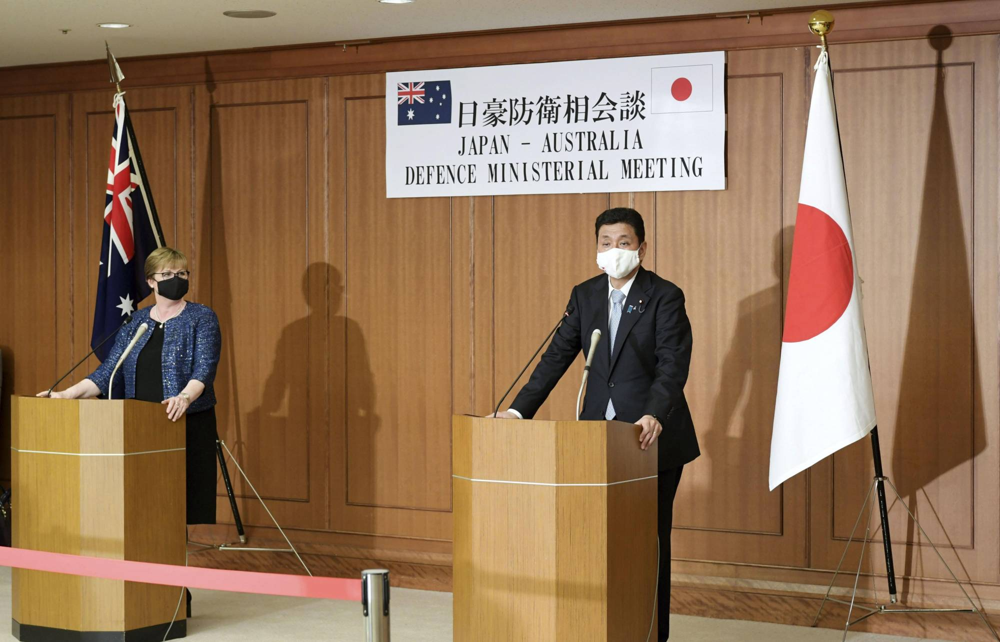 Defense Minister Nobuo Kishi and his Australian counterpart, Linda Reynolds, attend a joint news conference at the Defense Ministry in Tokyo on Monday. | KYODO