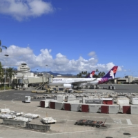An airplane is parked at a terminal at the the Daniel K. Inouye International Airport Thursday in Honolulu. A new travel testing program has recently gone into effect, allowing visitors who test negative for COVID-19 to come to Hawaii and avoid two weeks of mandatory quarantine. | AP