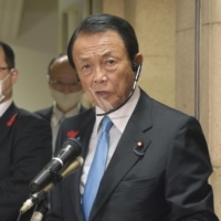 Finance Minister Taro Aso said the financial authorities will take appropriate steps to prevent a recurrence of the Tokyo Stock Exchange's full-day trading suspension. | KYODO