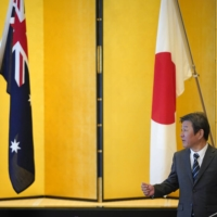 Foreign Minister Toshimitsu Motegi gestures toward Australian Foreign Minister Marise Payne prior to their luncheon meeting at the Iikura Guest House in Tokyo on Oct. 7. | POOL / VIA AP