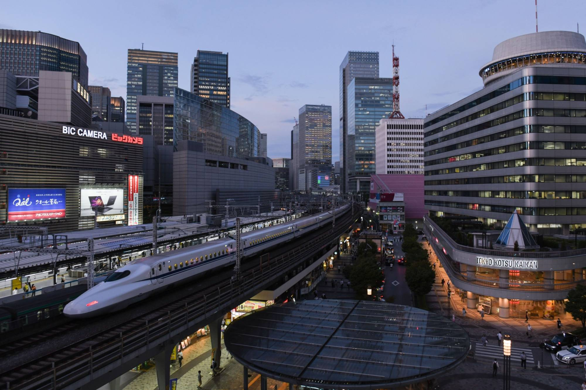 The Bank of Japan is expected to consider cutting its price projections for the year ending in March to account for the downward price pressure of the government's Go To Travel campaign, which subsidizes domestic travel. | BLOOMBERG