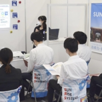Students attend a job fair in Tokyo in September. | KYODO
