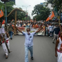 Bharatiya Janata Party supporters take part in a rally backing the agriculture bills of Indian Prime Minister Narendra Modi's government on Oct. 3. | AFP-JIJI