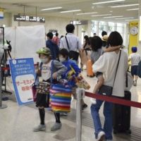 Passengers arrive at Naha Airport in Okinawa Prefecture on Oct. 3, the first weekend after Tokyo was added to the Go To Travel campaign. | KYODO
