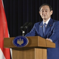 Prime Minister Yoshihide Suga speaks at a news conference in Jakarta on Wednesday. | KYODO