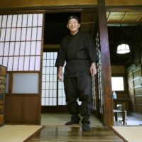Historical spot: A city official shows off the inside of a historic house in Hirosaki, Aomori Prefecture, supposedly used as a ninja base hundreds of years ago. | KYODO
