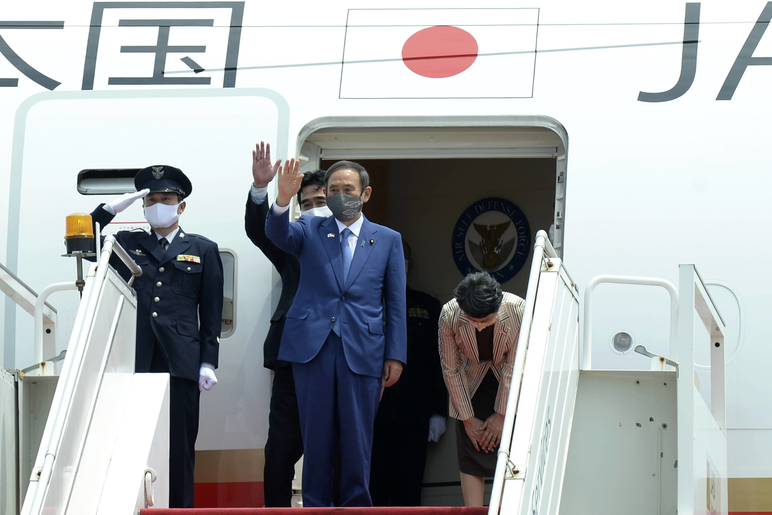 Prime Minister Yoshihide Suga waves as he readies to leave Jakarta on Wednesday. China is credited for making Southeast Asia a priority for Japan, but the region has always been important to Tokyo. | PRESIDENTIAL PALACE / VIA AP