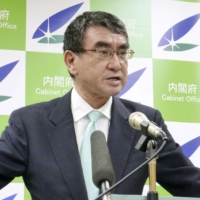 Taro Kono, minister in charge of regulatory reform, has been working to end the unnecessary use of hanko seals in government procedures. | KYODO