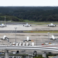 Narita International Airport Co. will waive landing and parking charges for all domestic flights, while reducing the amount for international flights, to help airlines. | KYODO
