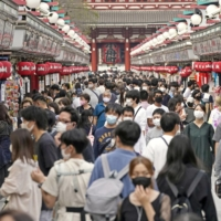 People fill the Nakamise shopping street in Tokyo's Asakusa district on Oct. 3, the first weekend after Tokyo was included in the Go To Travel campaign. Tokyo introduced its own travel subsidy program Friday. | KYODO