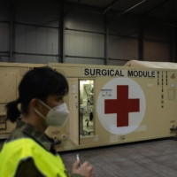 Newly installed shipping containers converted to 'surgical modules' for COVID-19 patients are installed in the Letnany exhibition hall in Prague on Thursday. | BLOOMBERG