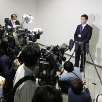 Miyagi Gov. Yoshihiro Murai speaks to reporters Thursday in Sendai after the Miyagi Prefectural Assembly approved a petition seeking the restart of the Onagawa nuclear power plant. | KYODO