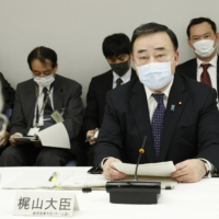 Economy, Trade and Industry Minister Hiroshi Kajiyama speaks during a government meeting convened Friday to discuss what to do with treated radioactive water from the crippled Fukushima nuclear plant. | KYODO
