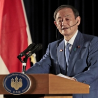 Prime Minister Yoshihide Suga speaks to the media during a news conference in Jakarta on Wednesday. | AP