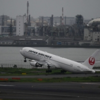 A Japan Airlines aircraft takes off at Haneda Airport in Tokyo on July 28. | BLOOMBERG