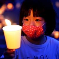 Candles are lit at the park marking the hypocenter in Nagasaki on Aug. 9, the 75th anniversary of the U.S. atomic bombing of the city. | KYODO
