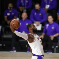 The Lakers' LeBron James dunks during the first half in Game 6 of the NBA Finals in Lake Buena Vista, Florida, on Oct. 11. | AP