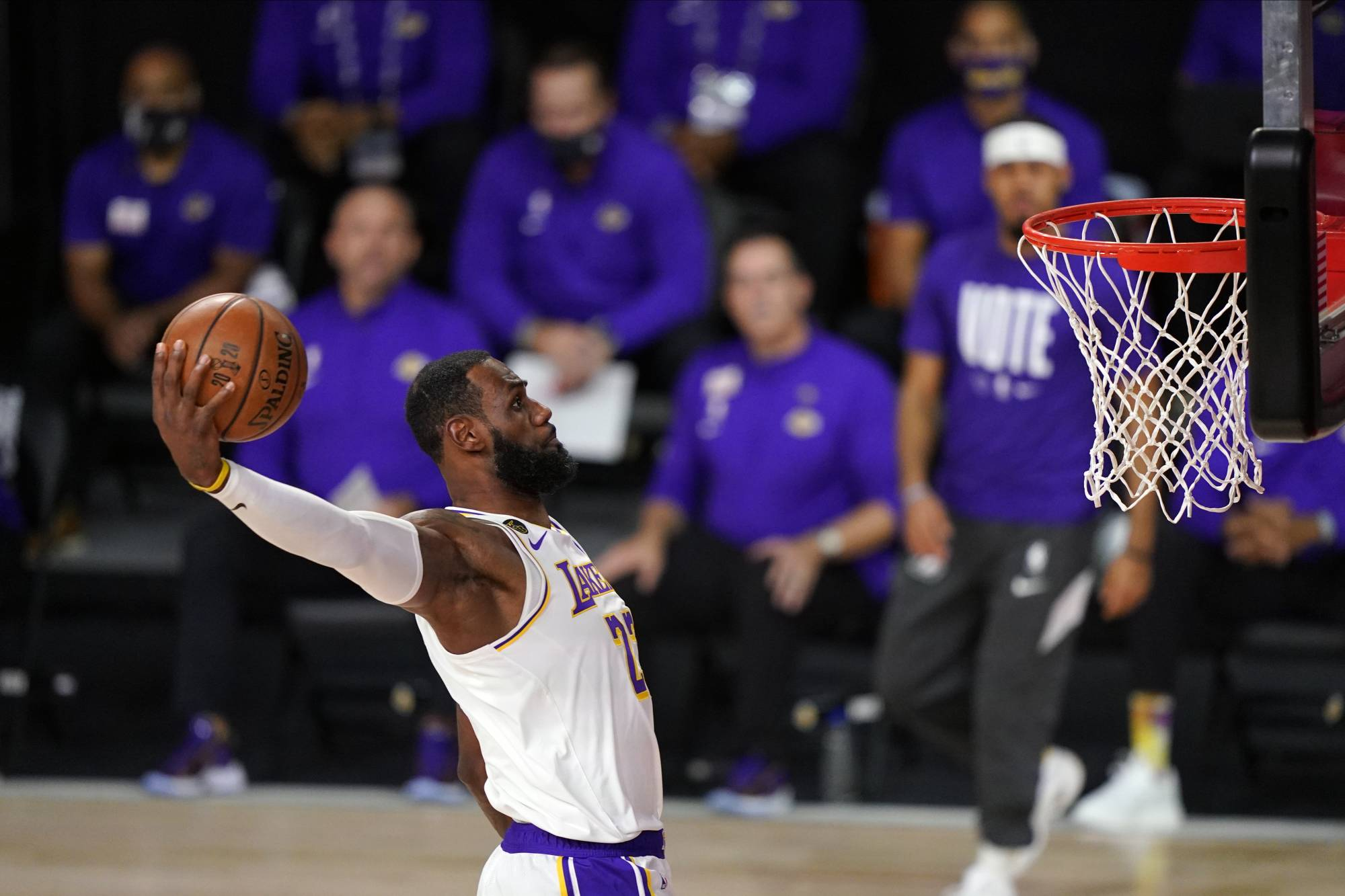 The Lakers' LeBron James dunks during the first half in Game 6 of the NBA Finals in Lake Buena Vista, Florida, on Oct. 11.   AP