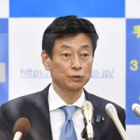 Yasutoshi Nishimura, minister in charge of the nation's coronavirus response, says the government will consider a system to make it easier for people with no COVID-19 symptoms to take PCR tests. | KYODO