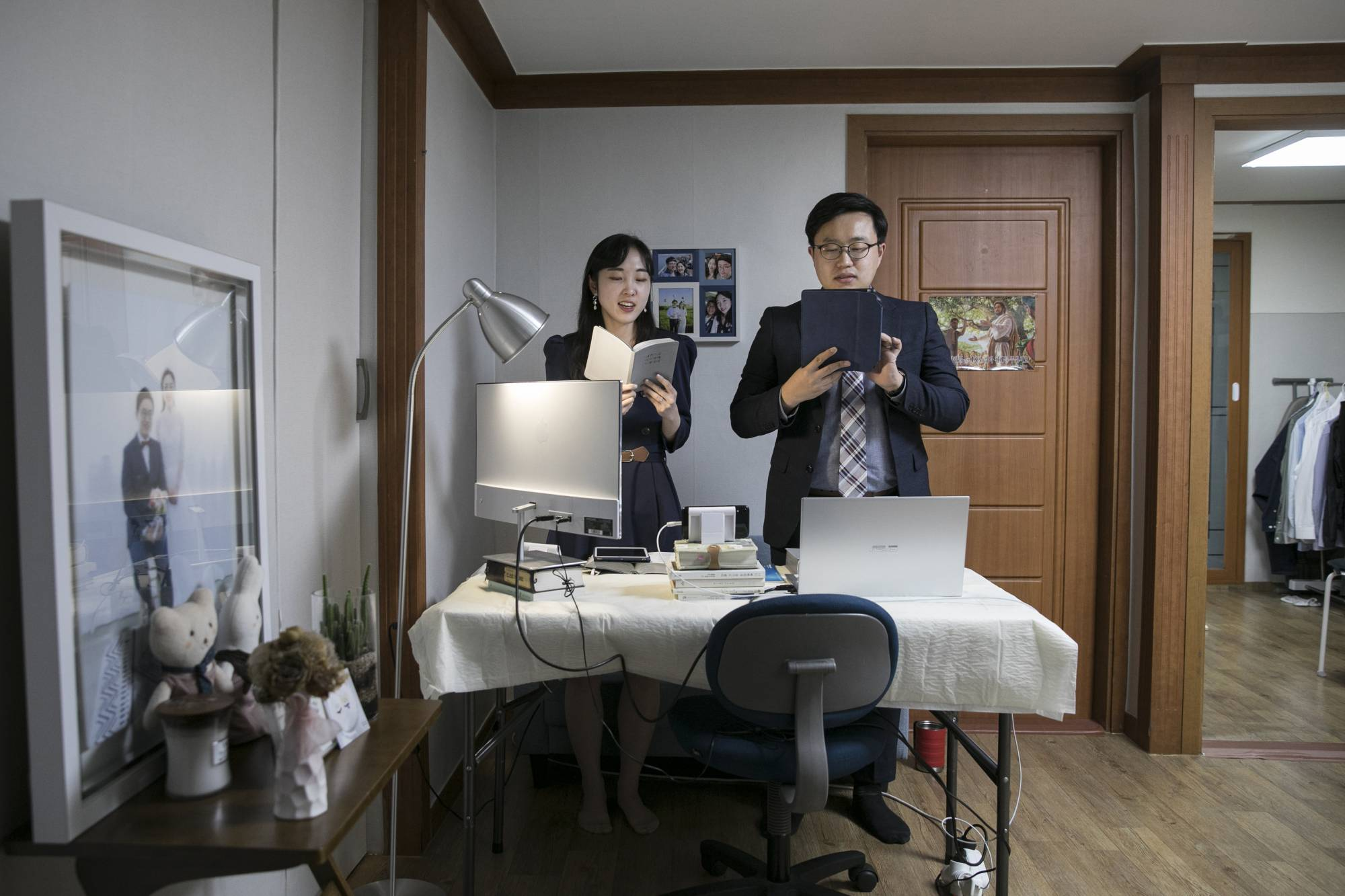 Kim Keun-hyeong, a conscientious objector, and his wife, Kim Seoyoung, prepare for an online church service in Bucheon, South Korea. | WOOHAE CHO / THE NEW YORK TIMES