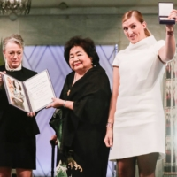 Hiroshima atomic bombing survivor Setsuko Thurlow (center) and ICAN Executive Director Beatrice Fihn (right) attend the awards ceremony for the Nobel Peace Prize in Oslo in December 2017. Thurlow and Finh led a successful campaign pushing for the ratification of the Treaty on the Prohibition of Nuclear Weapons. | NTB SCANPIX / TBERIT ROALD / VIA REUTERS