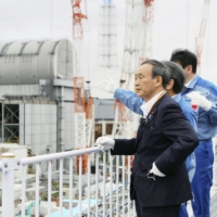 Prime Minister Yoshide Suga visited the Fukushima No. 1 nuclear power plant on Sept. 26, a month before vowing to reduce Japan's carbon emissions to zero by 2050. | POOL / VIA KYODO