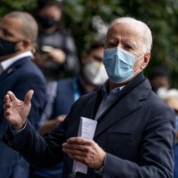 Democratic presidential candidate Joe Biden speaks with people outside a voter service center on Monday in Chester, Pennsylvania.    AP
