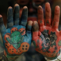 Author Hiroki Takamura, 62, shows off tattoos on his palms at the annual gathering of the Irezumi Aikokai (Tattoo Lovers Association) in Tokyo in February. | REUTERS