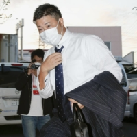 Junichi Tazawa arrives ahead of a planned news conference on Monday in Kumagaya, Saitama Prefecture. | KYODO