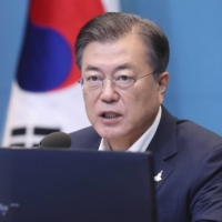 South Korean President Moon Jae-in has rolled out four stimulus packages as part of measures to assist the economy during the pandemic. | LEE JIN-WOOK / YONHAP / VIA AP