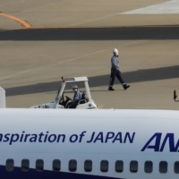ANA Holdings Inc. has forecast its biggest-ever operating loss, of ¥505 billion, for the fiscal year through March 2021. | REUTERS