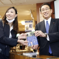 Fumio Kishida promotes his book calling for the elimination of nuclear weapons on Oct. 15. | KYODO