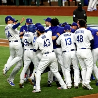 The Dodgers celebrate after beating the Rays in Game 6 of the World Series on Tuesday in Arlington, Texas. | USA TODAY / VIA REUTERS