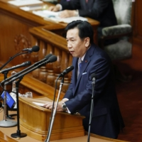 Yukio Edano, head of the Constitutional Democratic Party of Japan, offers questions at the Lower House plenary session Wednesday. | KYODO