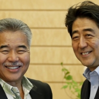 Hawaii Gov. David Ige meets with then-Prime Minister Shinzo Abe in Tokyo in June 2015.       REUTERS
