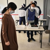 Tokyo Olympic volunteer group training resumes after 8-month halt