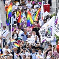 People hold a rally in Tokyo against discrimination toward sexual minorities in April 2019. | KYODO