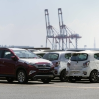 Toyota Motor Corp. vehicles bound for shipment sit at the Nagoya Port in August. Toyota's global output for September hit a record high. | BLOOMBERG