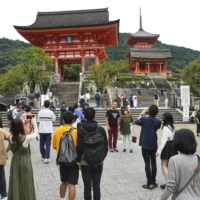 Tourists crowd the area around Kiyomizu Temple in Kyoto earlier this month as people take advantage of the Go To Travel tourism campaign. | KYODO