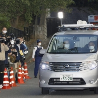 A police vehicle carrying actor Kentaro Ito leaves Harajuku Police Station in Tokyo on Thursday.
