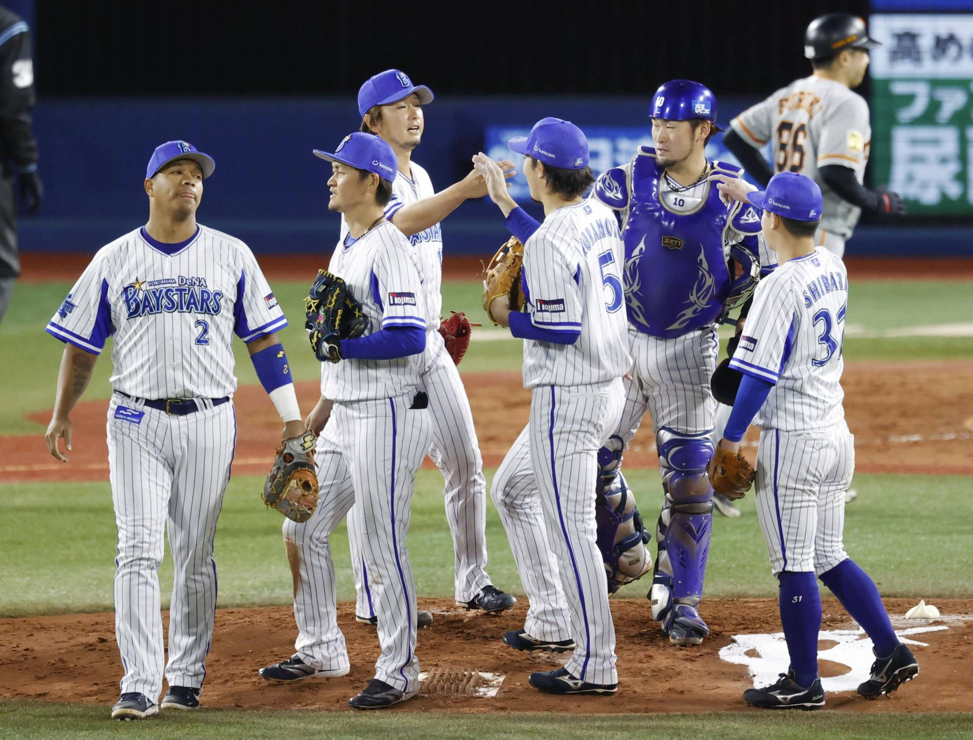BayStars players celebrate after earning a third straight win over the Giants on Thursday in Yokohama. | KYODO
