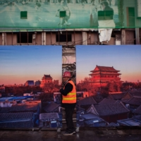 A worker leaves a construction site in Beijing on Wednesday,  | AFP-JIJI