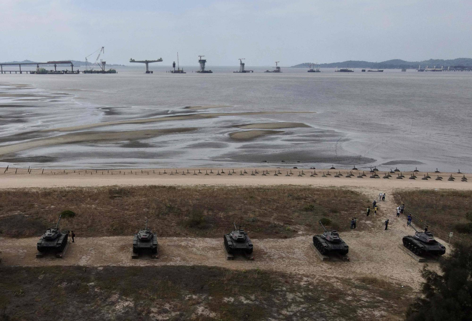 Anti-landing spikes and retired tanks placed along the coast of Taiwan's Kinmen islands, just off the coast of mainland China. | AFP-JIJI