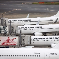 Japan Airlines Co. said it logged a net loss of ¥161.23 billion in the first half of fiscal 2020. | AFP-JIJI