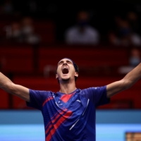 Lorenzo Sonego celebrates after beating Novak Djokovic in their quarterfinal match at the Erste Bank Open on Friday in Vienna. | REUTERS