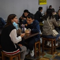 People eat at a restaurant in Shanghai on Oct. 25.  | AFP-JIJI