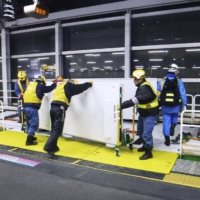 Workers install safety doors at Akabane Station in Tokyo in December 2017. | JR EAST / VIA KYODO