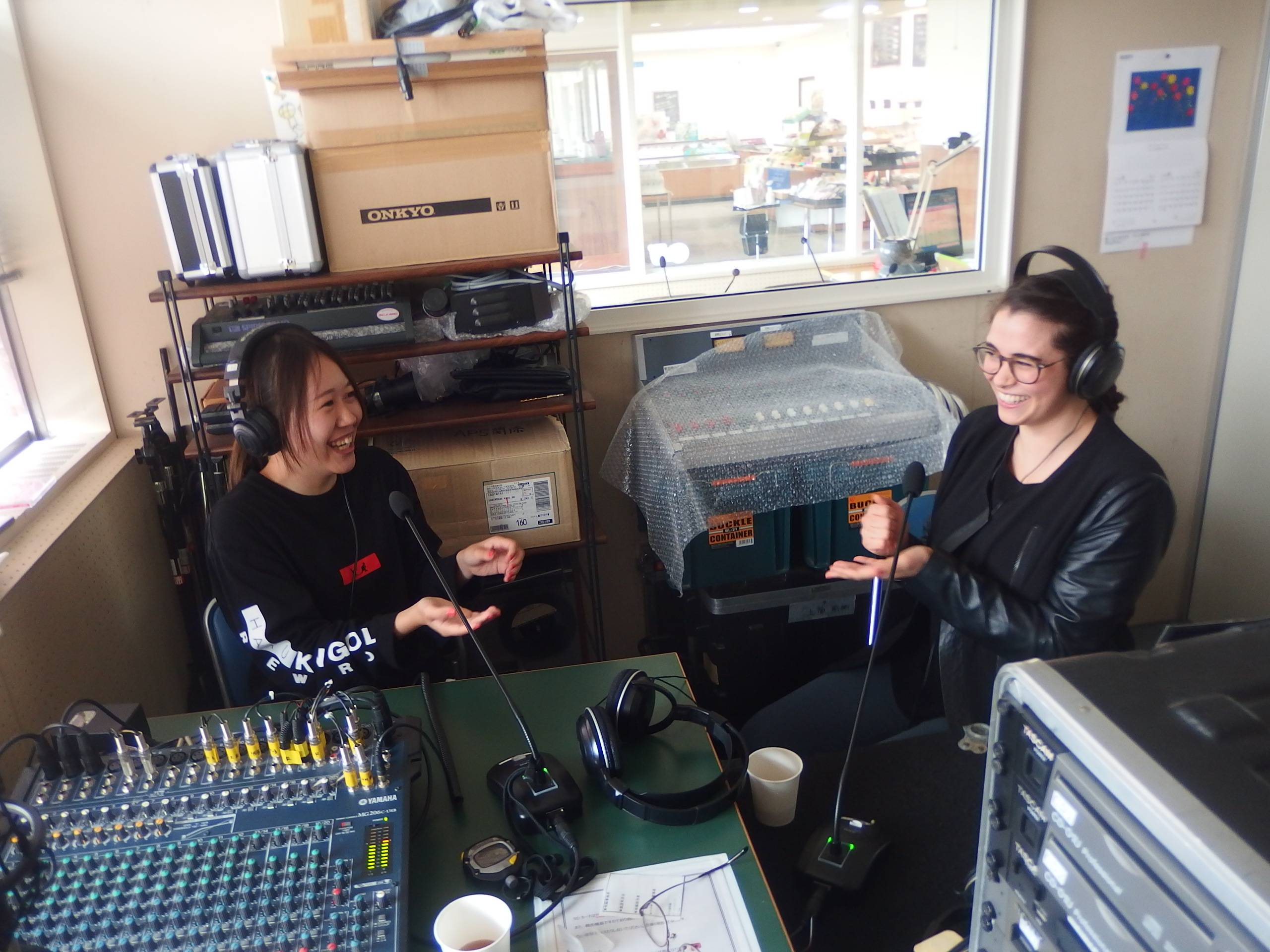 Cultural exchange on the dial: Saki Shiina and American Marina Pate record the 'Kantan Eikaiwa Kyoshitsu' ('Easy English Conversation Classroom') show. | COURTESY OF KAZUAKI SATO