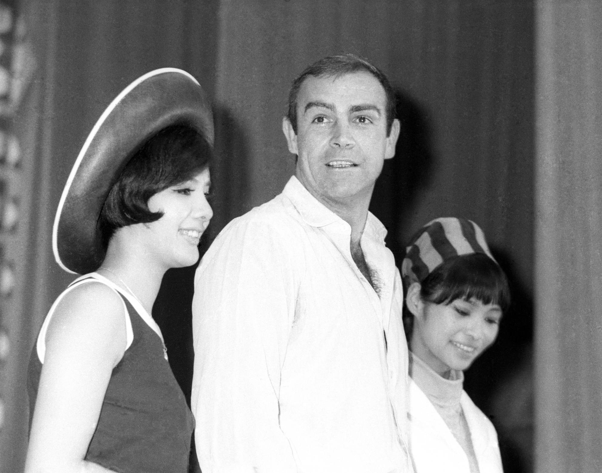 Sean Connery, with Bond girls Mie Hama (left) and Akiko Wakabayashi, at news conference in Tokyo for