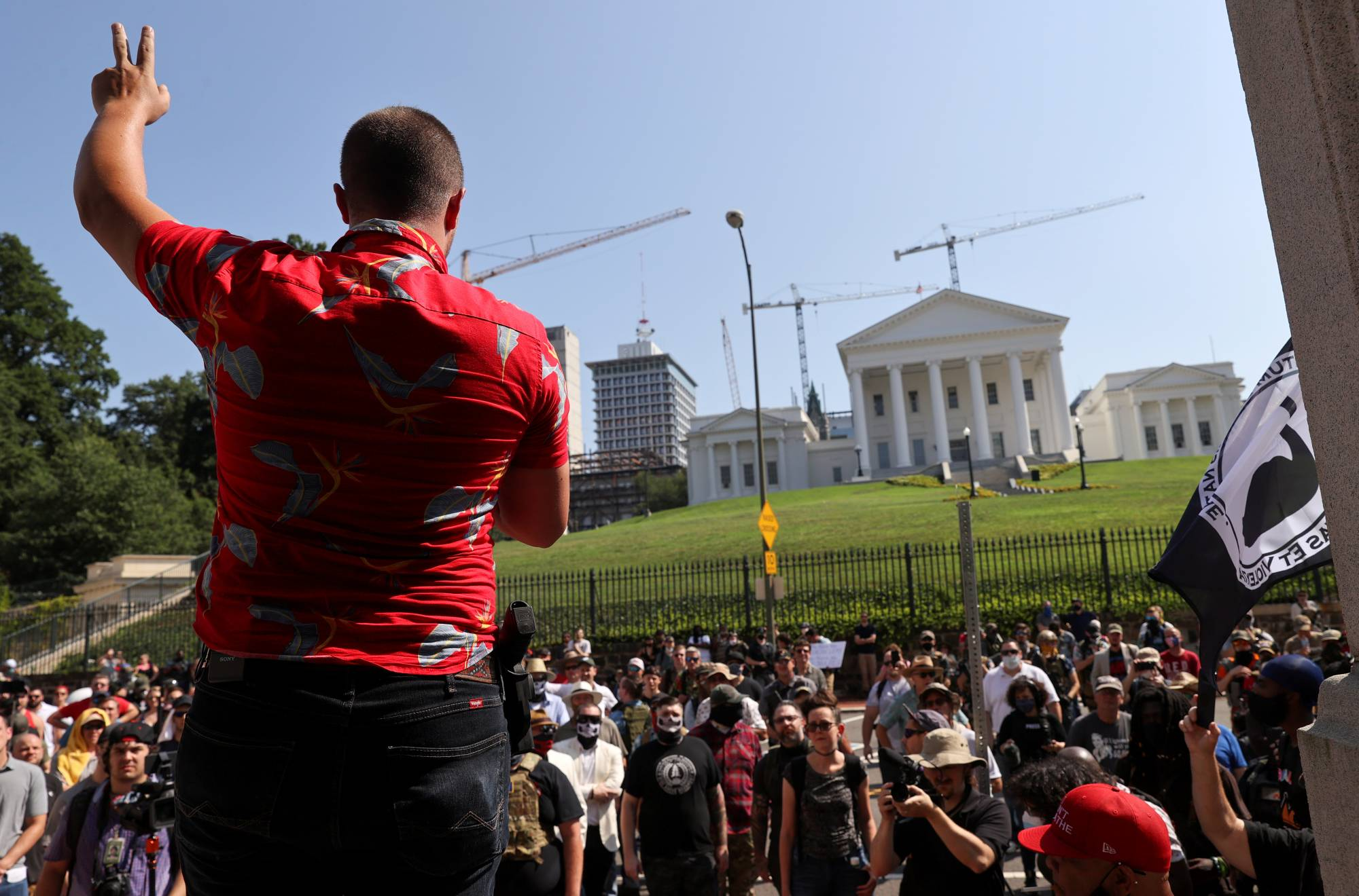Protest leader Mike Dunn gestures as he speaks during a rally in Richmond, Virginia, in July. | REUTERS